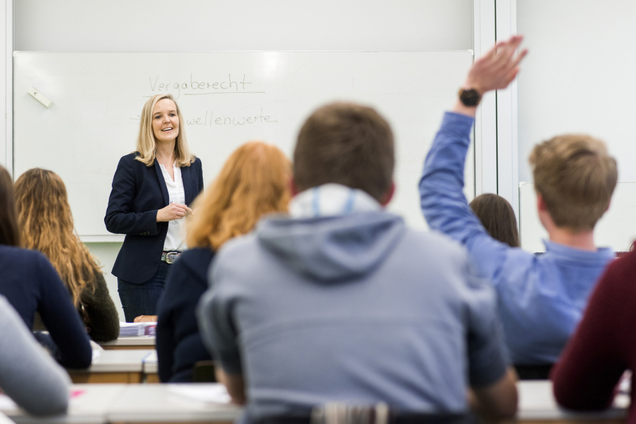 Female teacher in front of class