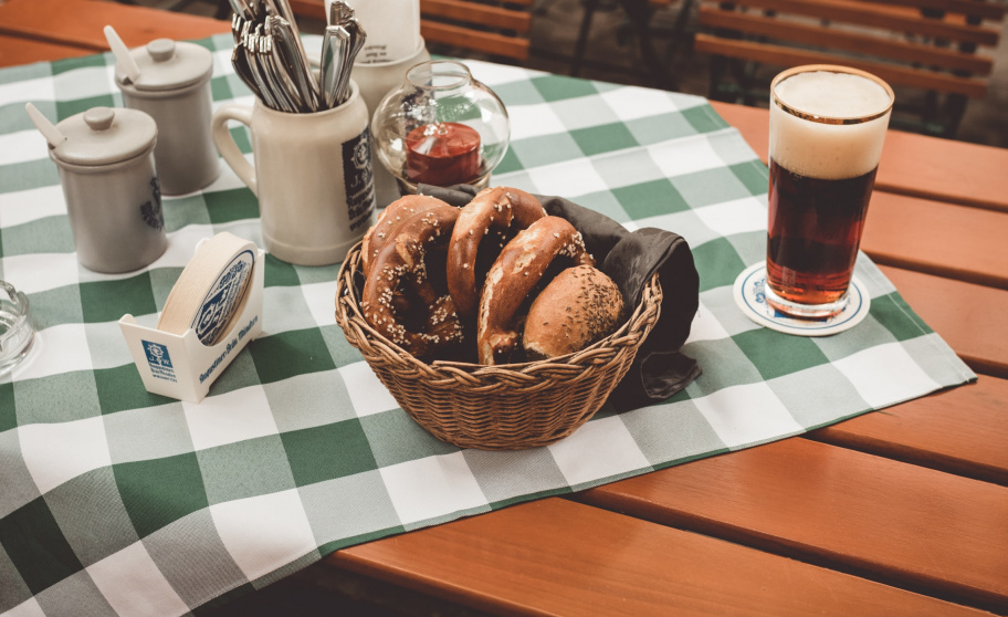"German ""Biergarten"" with bread and beer on a table"