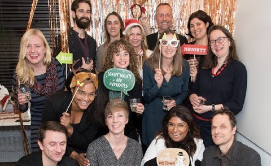 Group of people at holiday party with funny accessories
