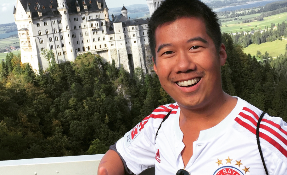 UAS7 alumnus Calvin Xu in front of Neuschwanstein castle